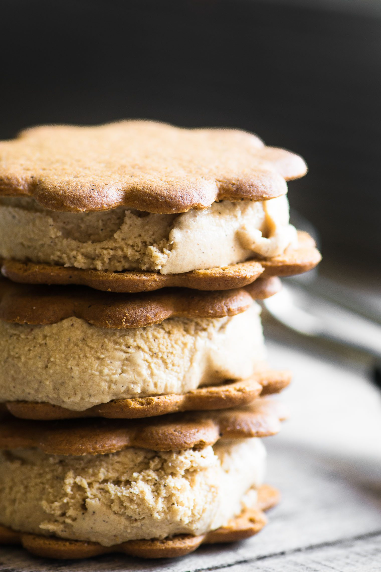 a stack of gingerbread ice cream sandwiches made with gingersnaps