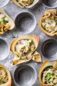 spicy tuna wonton cups in a mini muffin pan
