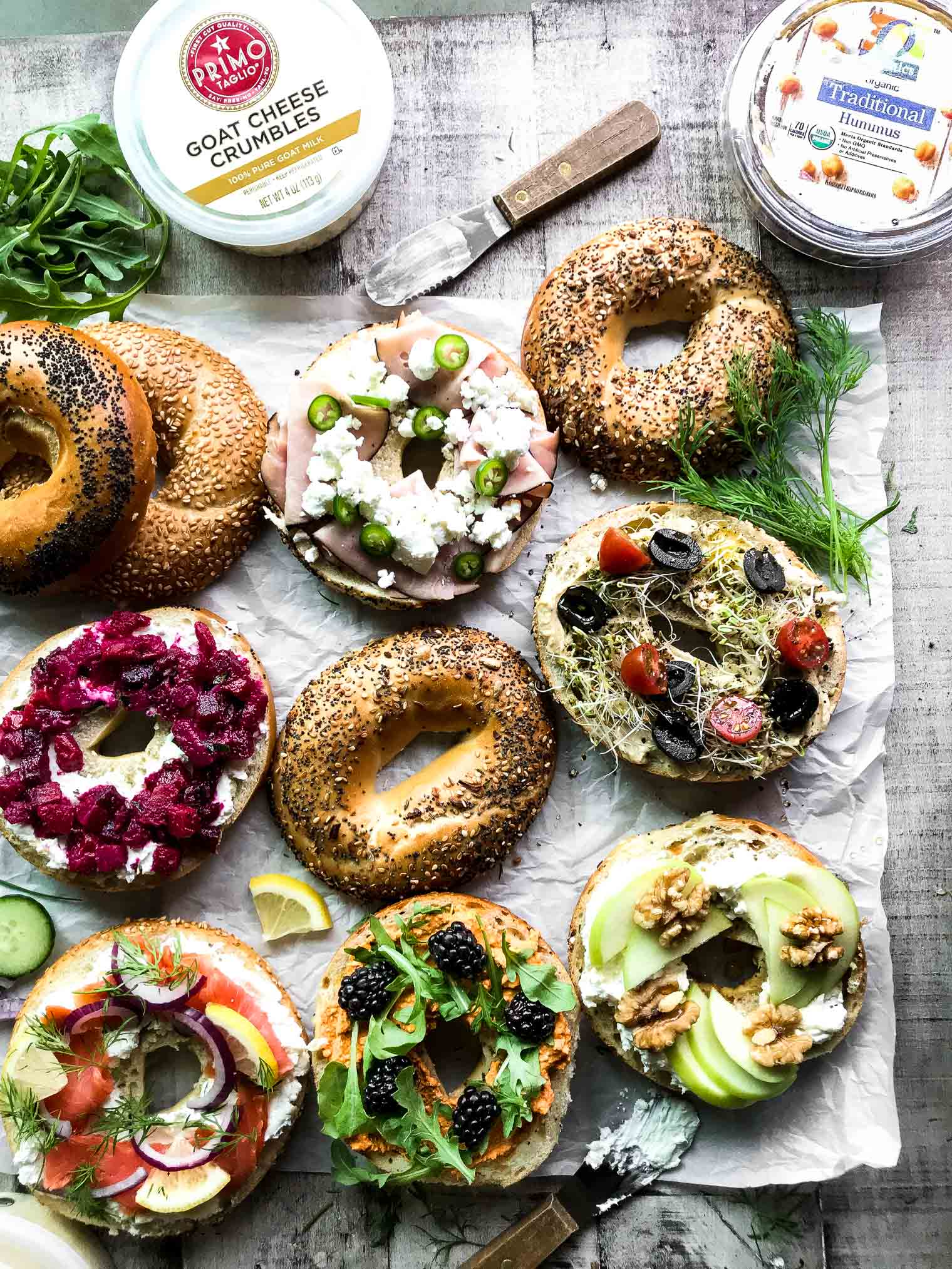 Irresistible Bagel Toast (your new favorite snack!) Bagels and toppings spread out on a table
