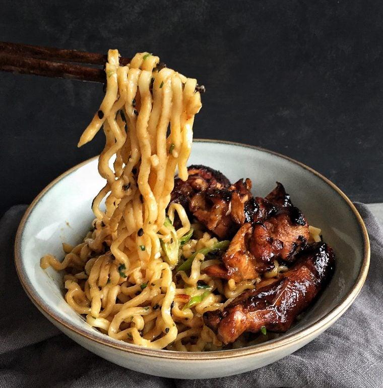 chopsticks holding noodles