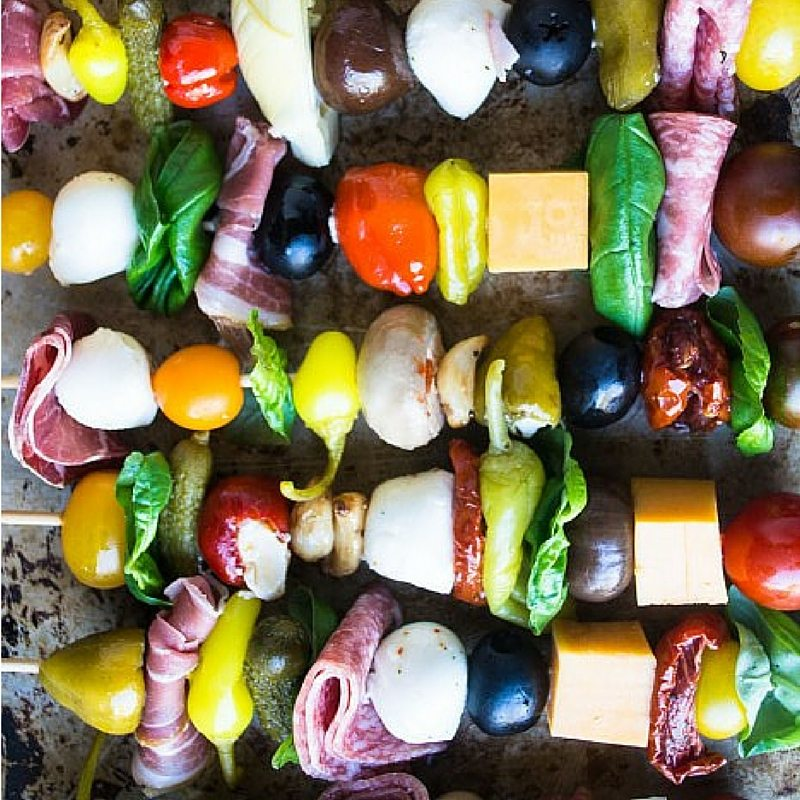 a colorful lineup of antipasto skewers