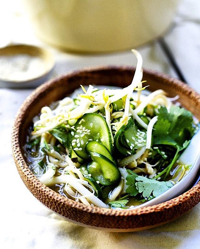 noodle bowl with fresh greens and herbs