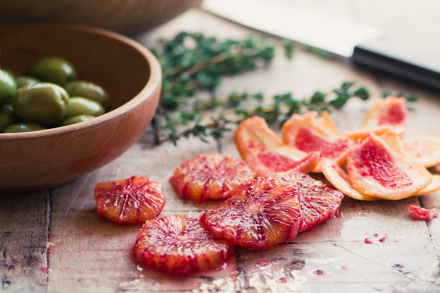 Slicing blood oranges for roast chicken wtih blood oranges and olives