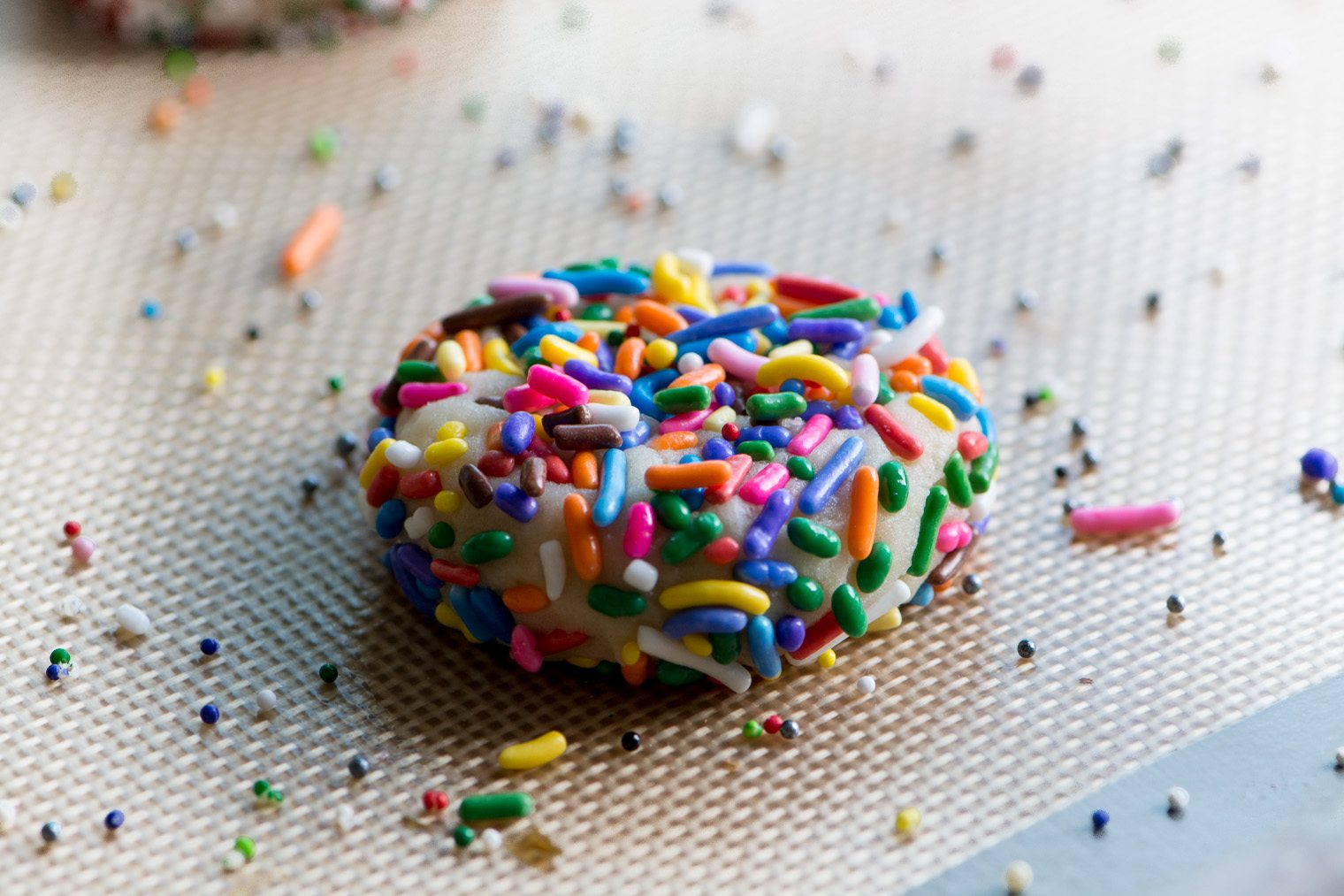 A sprinkle sugar cookie ready to be baked