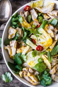 Saffron, chicken, and herb salad in a white bowl