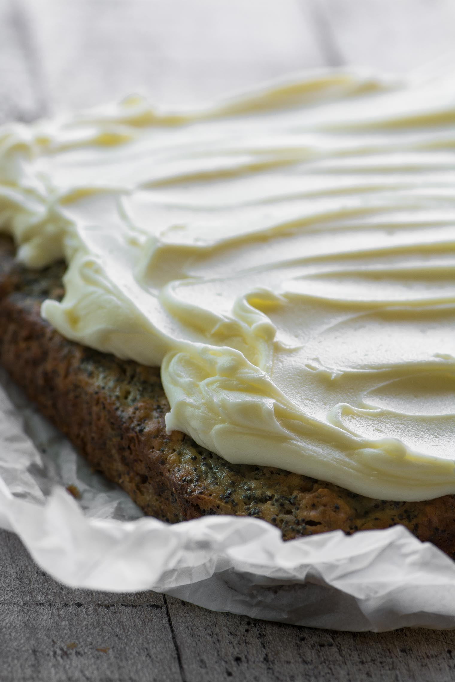 Banana Poppy Seed Cake with lemon buttercream frosting