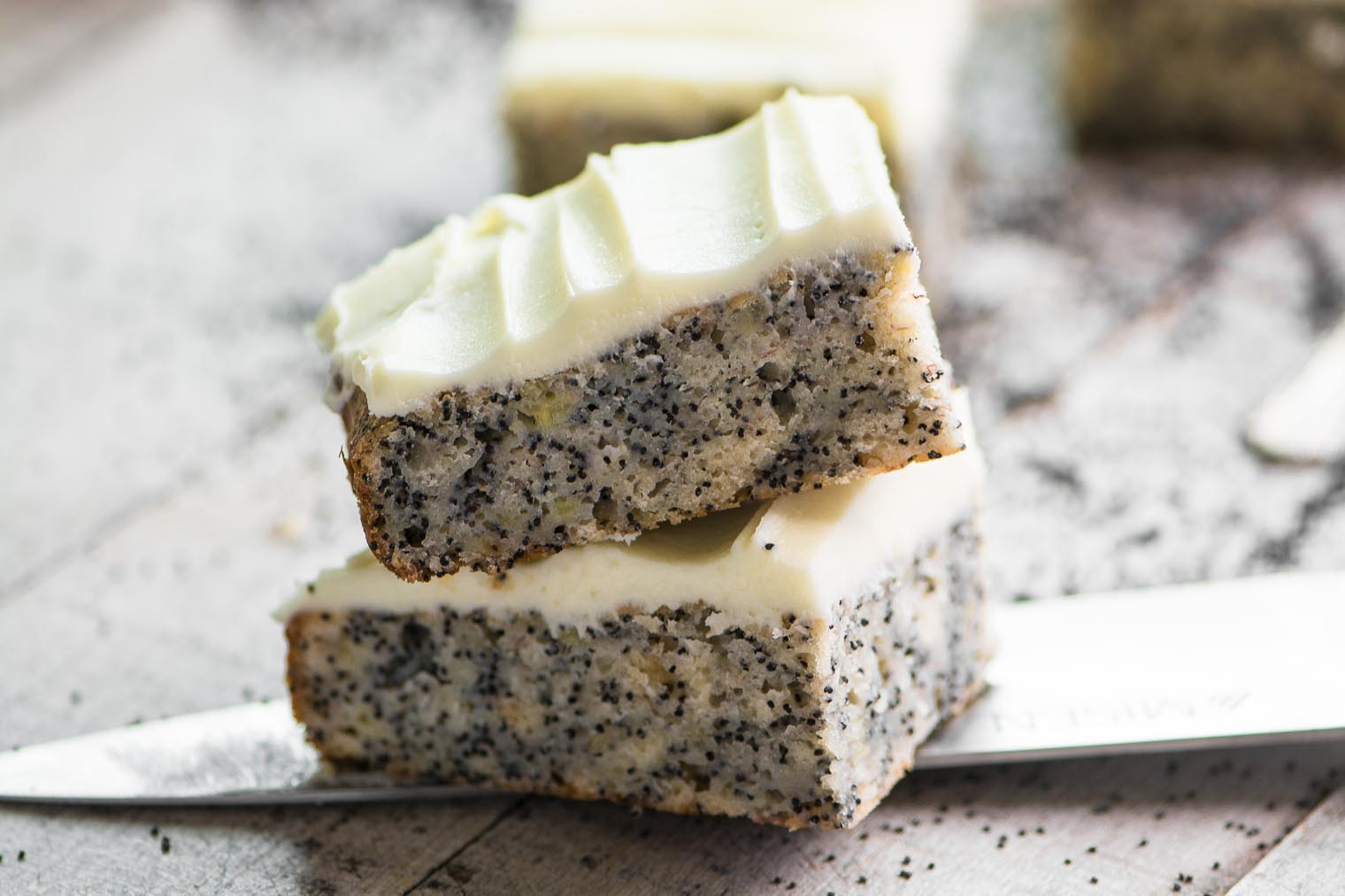 slices of banana poppy seed cake on a knife