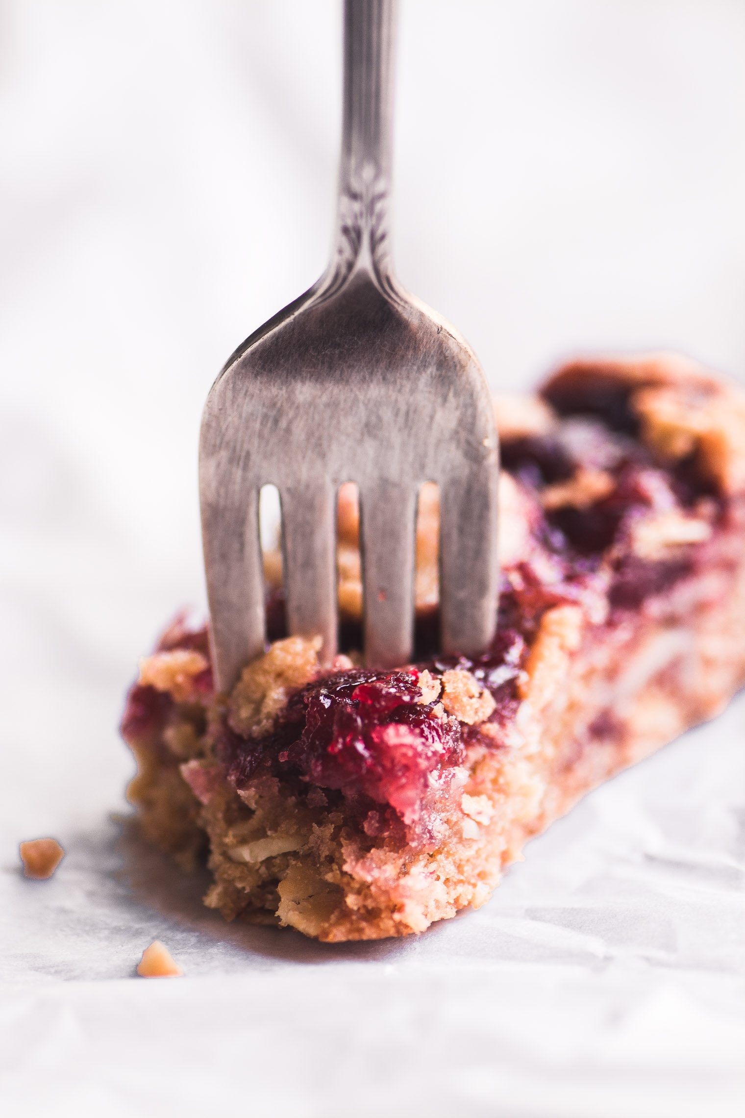 A sour cherry almond bar with fork