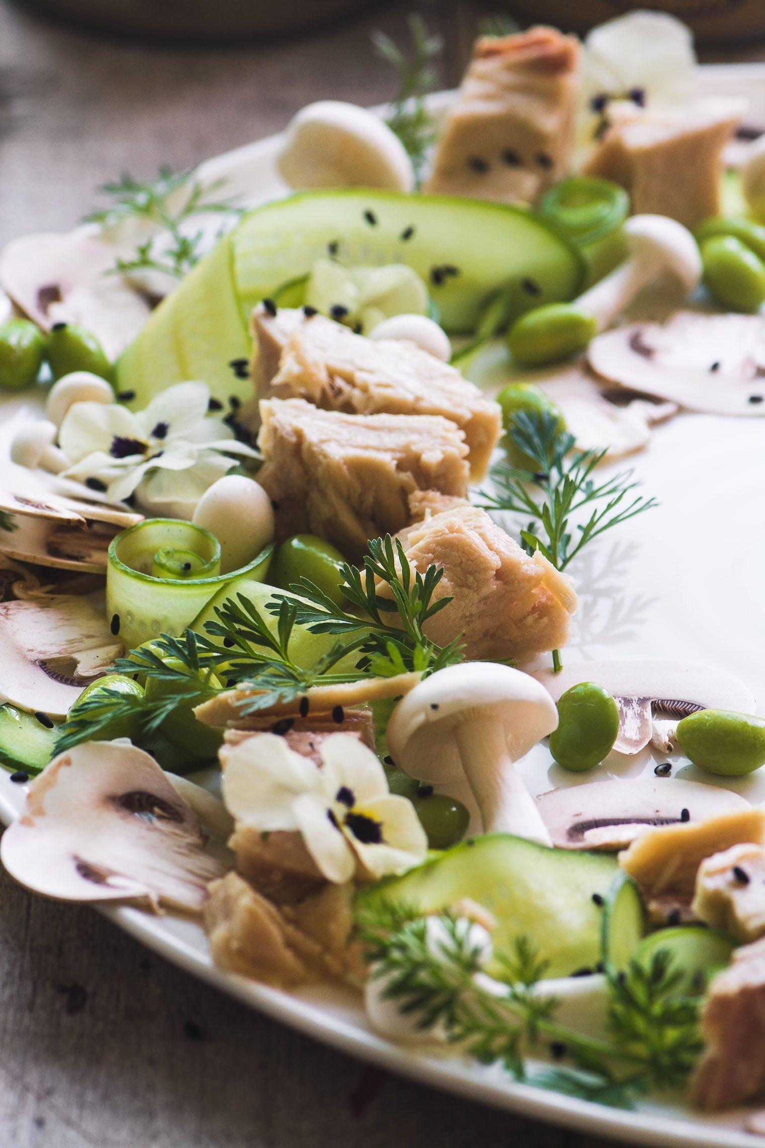 a tuna salad on a white plate