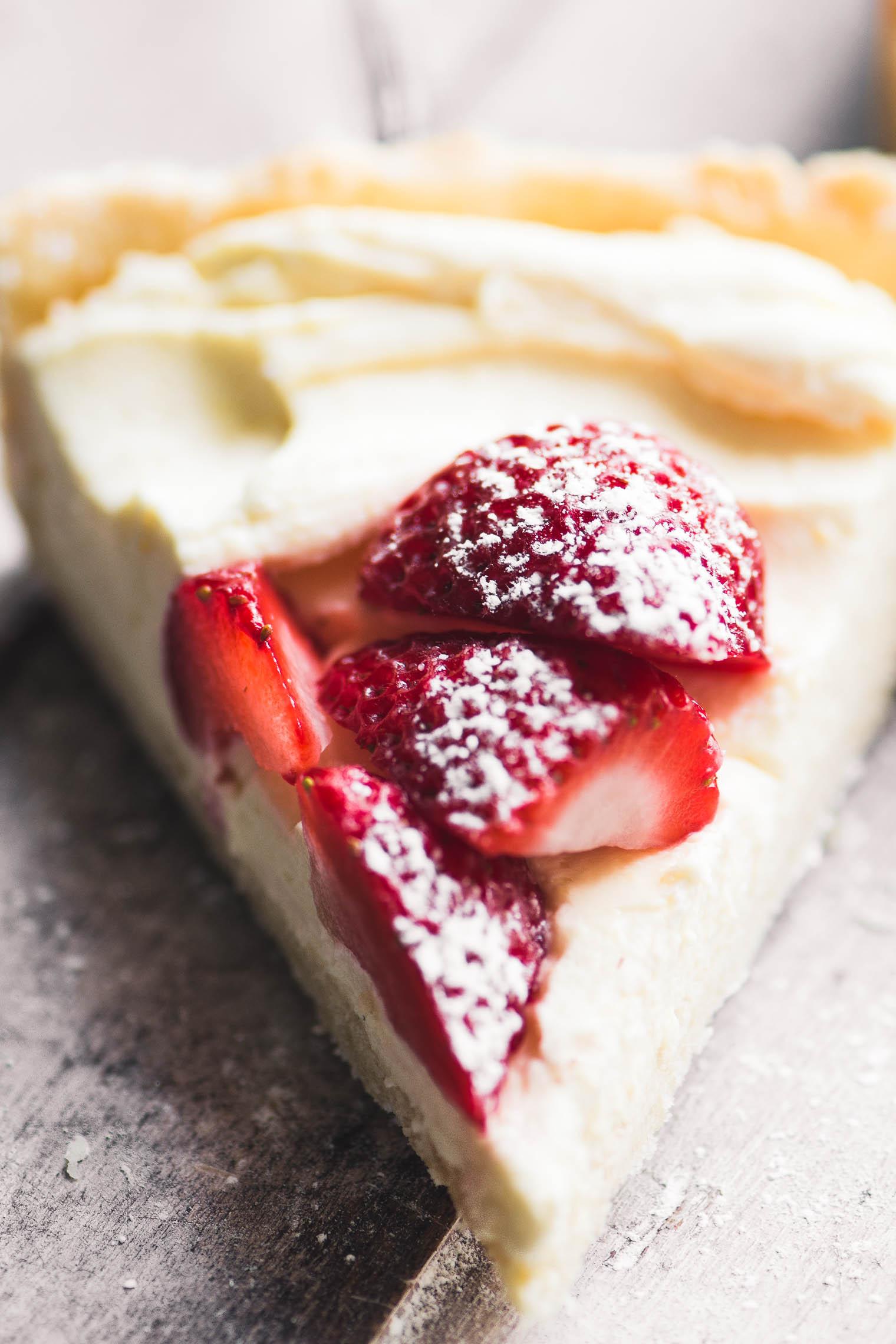 a slice of strawberries and cream tart