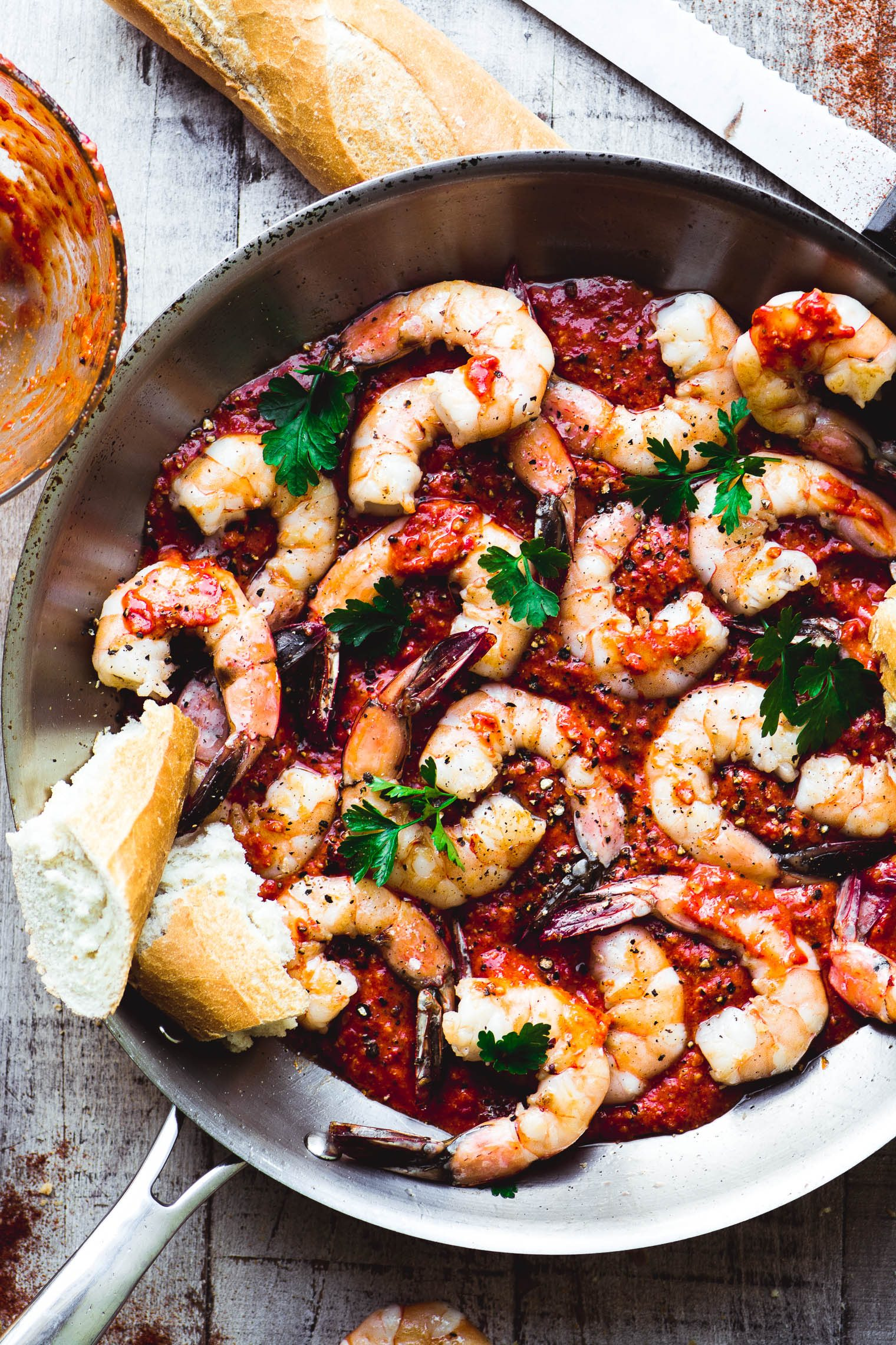 grilled shrimp with romesco sauce in a pan