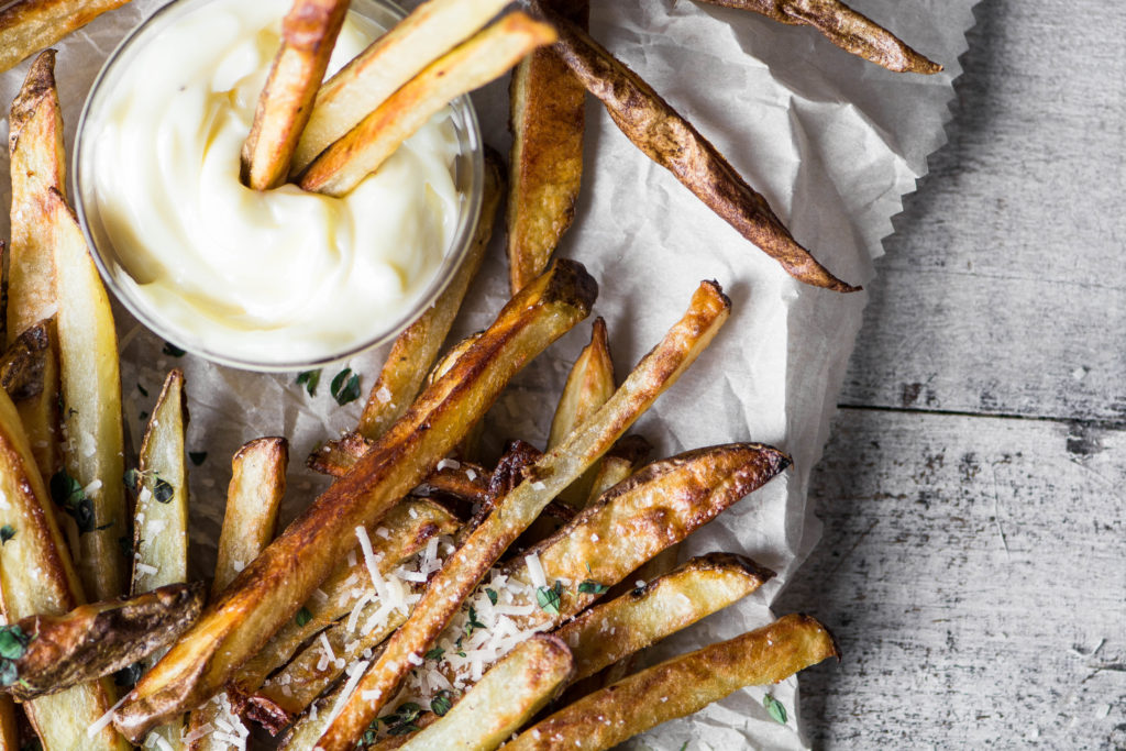 overhead photo of baked truffle fries with mayo dip