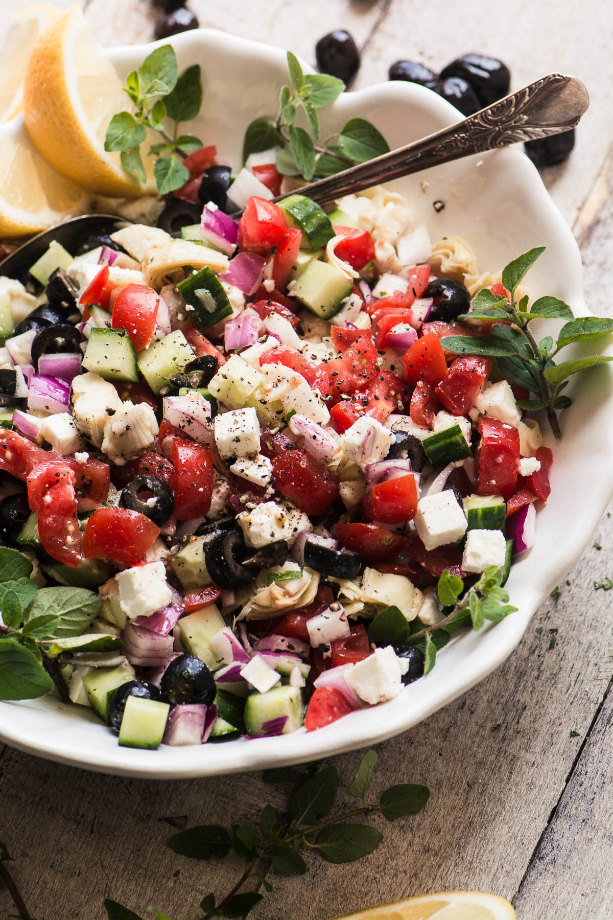 Chopped Greek salad in a white bowl