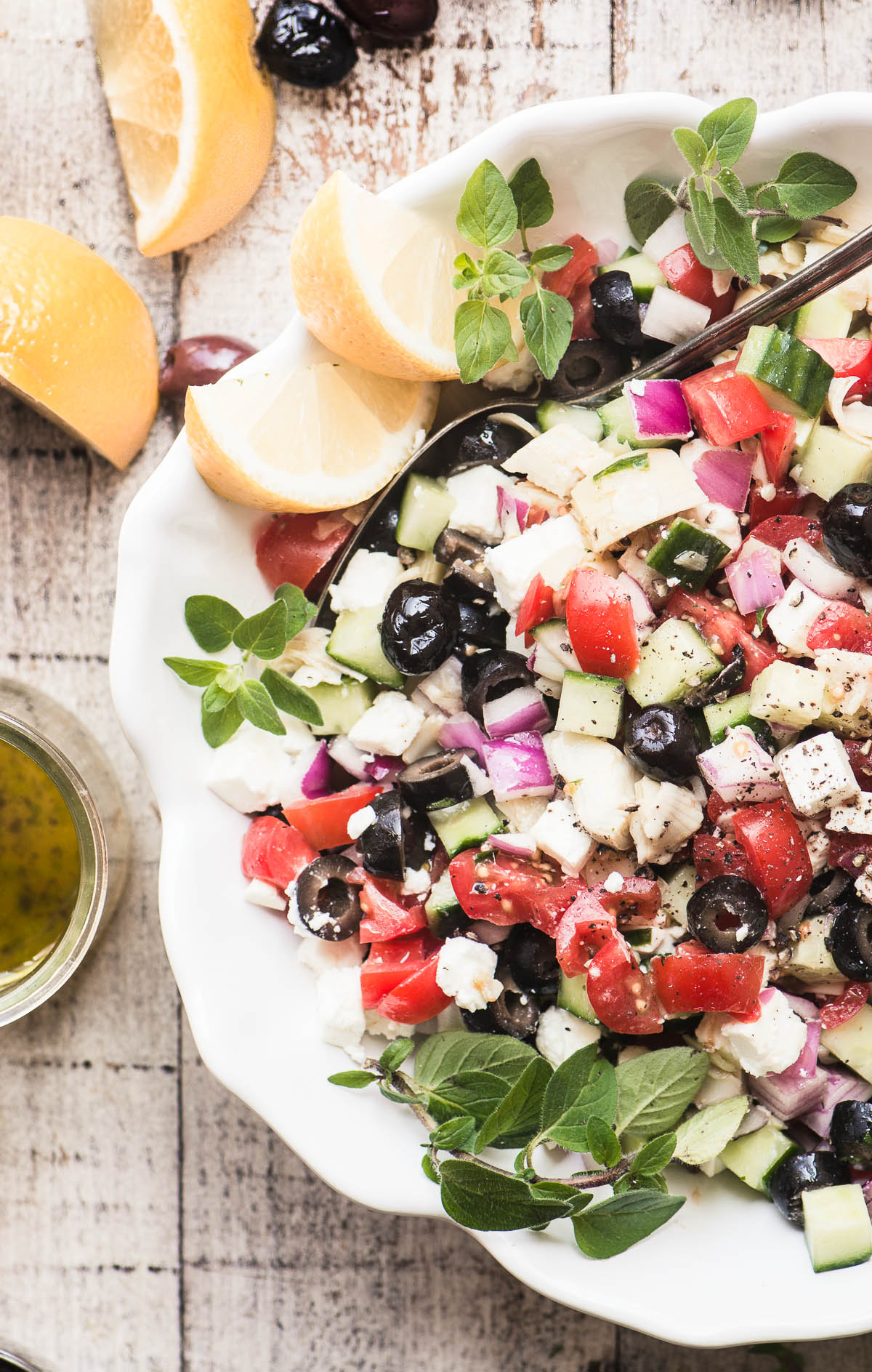 overhead photo of a chopped Greek salad in a white bowl