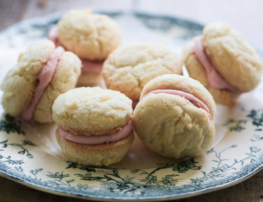 A plate of delicate roasted rhubarb lady's kiss cookies on a plate