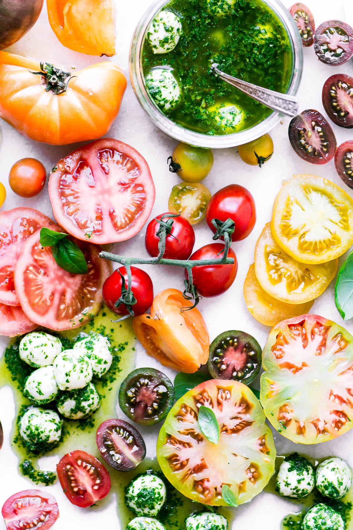 Colorful sliced tomatoes with basil marinated mozzarella