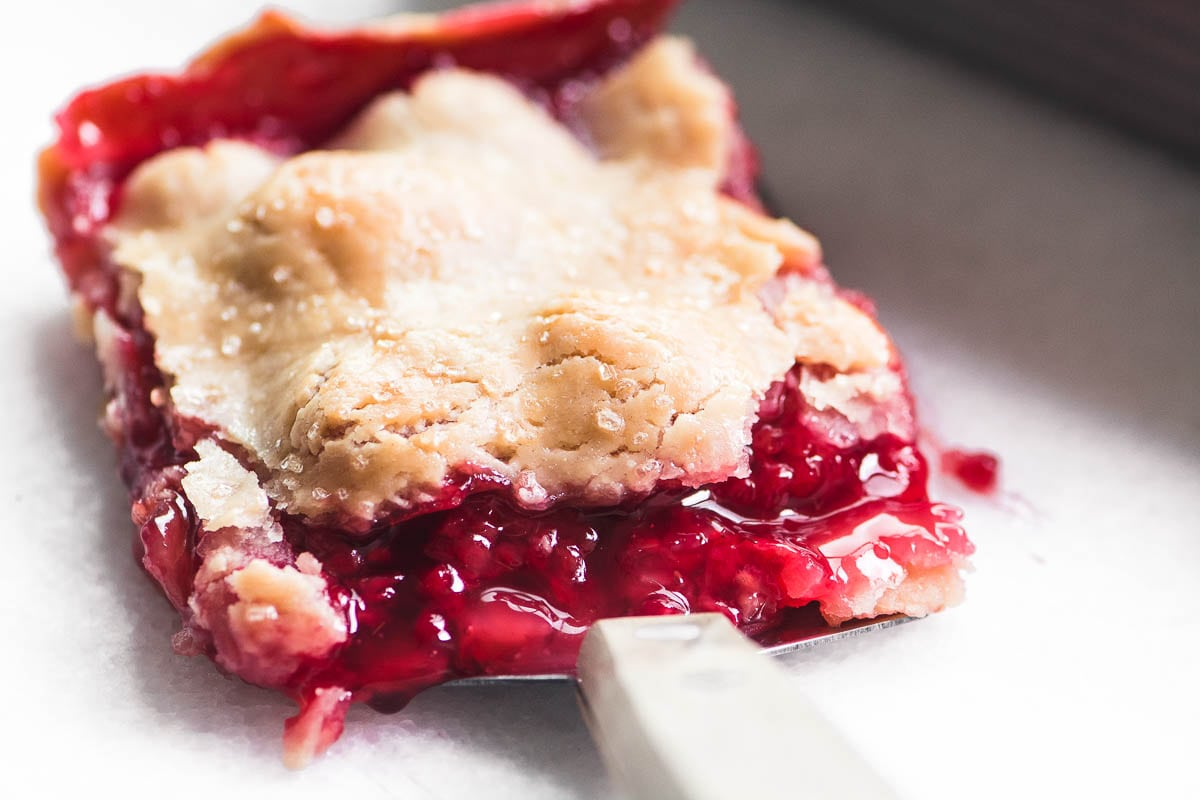 a piece of raspberry slab pie