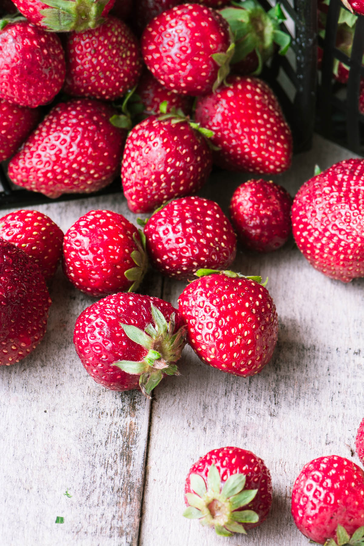 fresh strawberries on a wooden surface