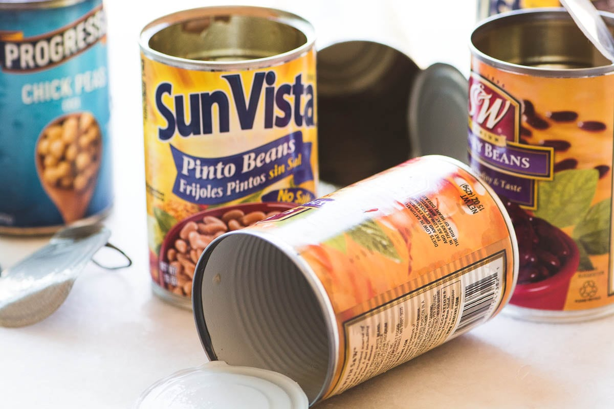 empty bean cans for charred corn and bean salad