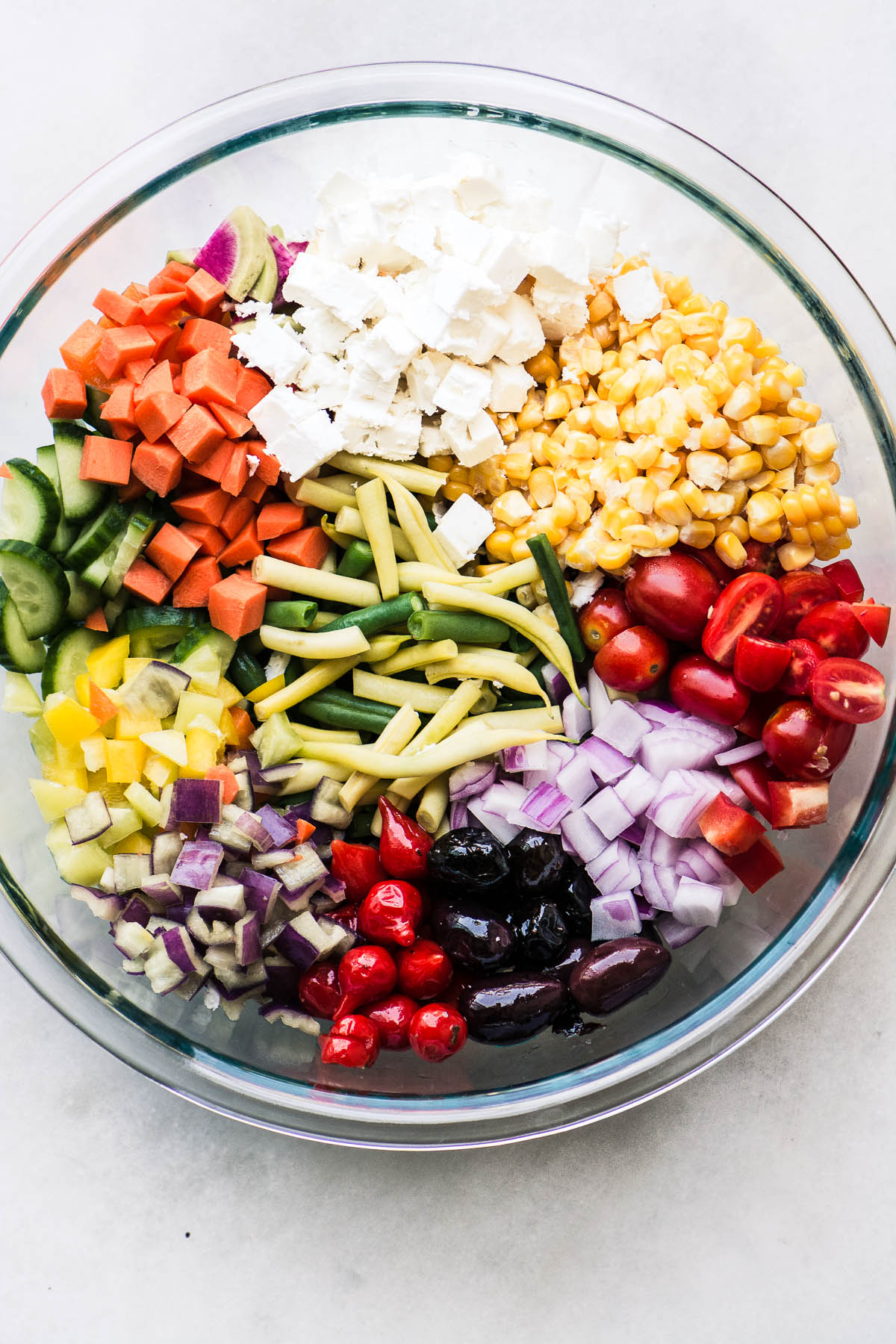 Chopped ingredients for Farmers Market Vegetable Salad in a glass bowl