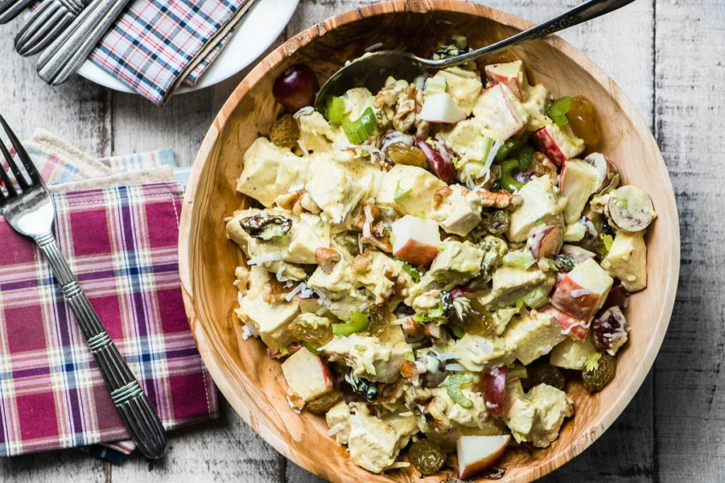 Curried Chicken Waldorf Salad in a wooden bowl