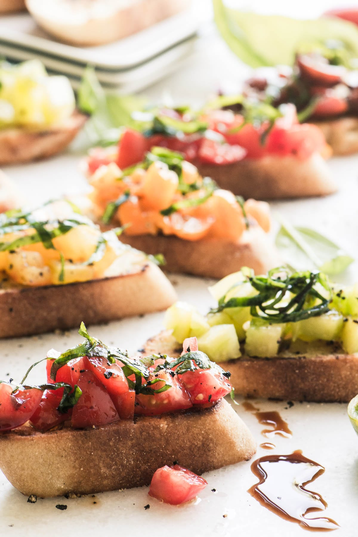 Best Heirloom Tomato Recipes ~ Heirloom Tomato Bruschetta on a white surface