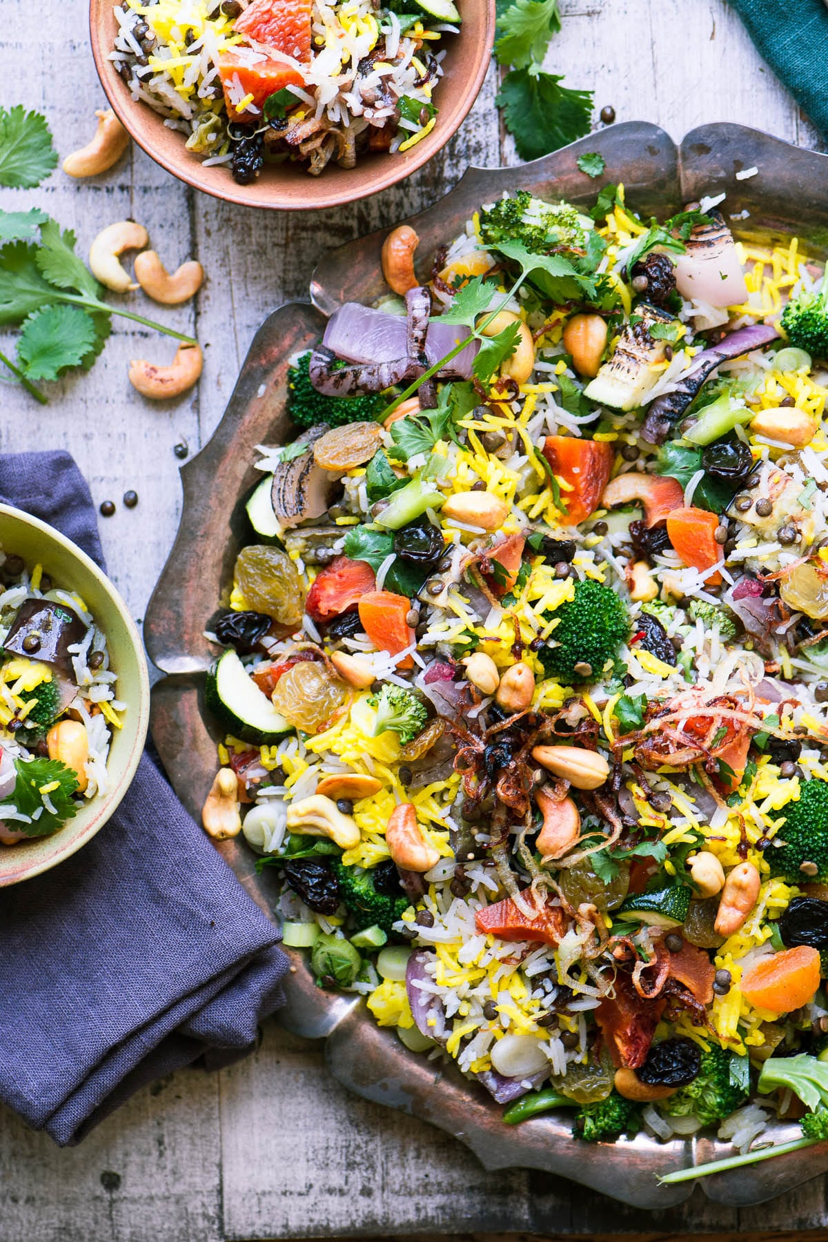 a large round platter of peach and cashew biryani salad