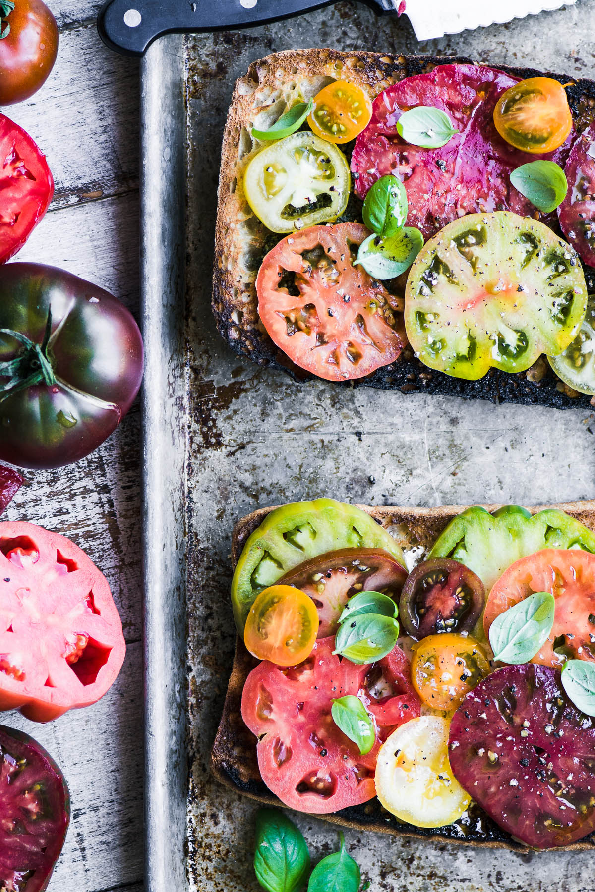 Making heirloom tomato toast with colorful tomatoes