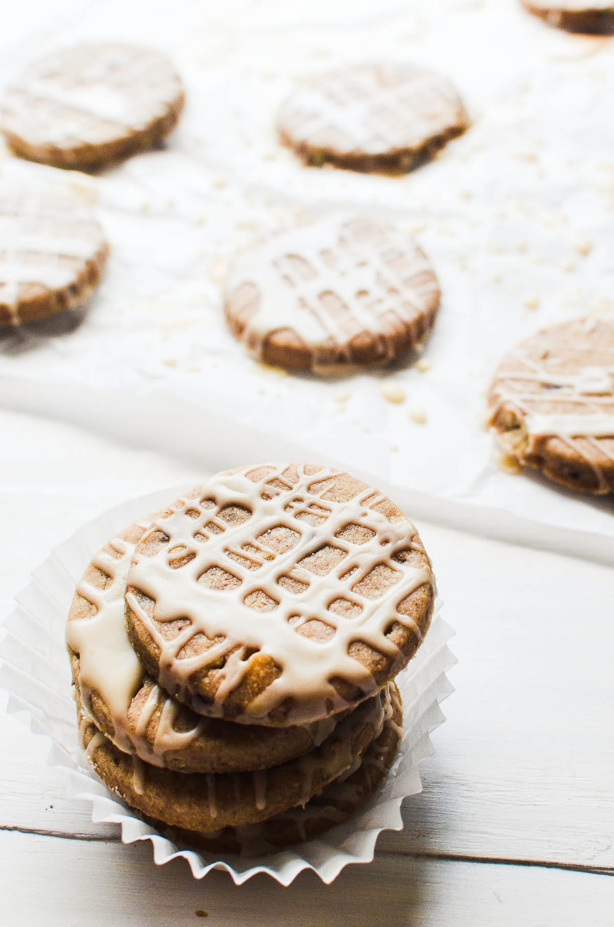 Honey Spice Hazelnut Cookies stacked on a white table