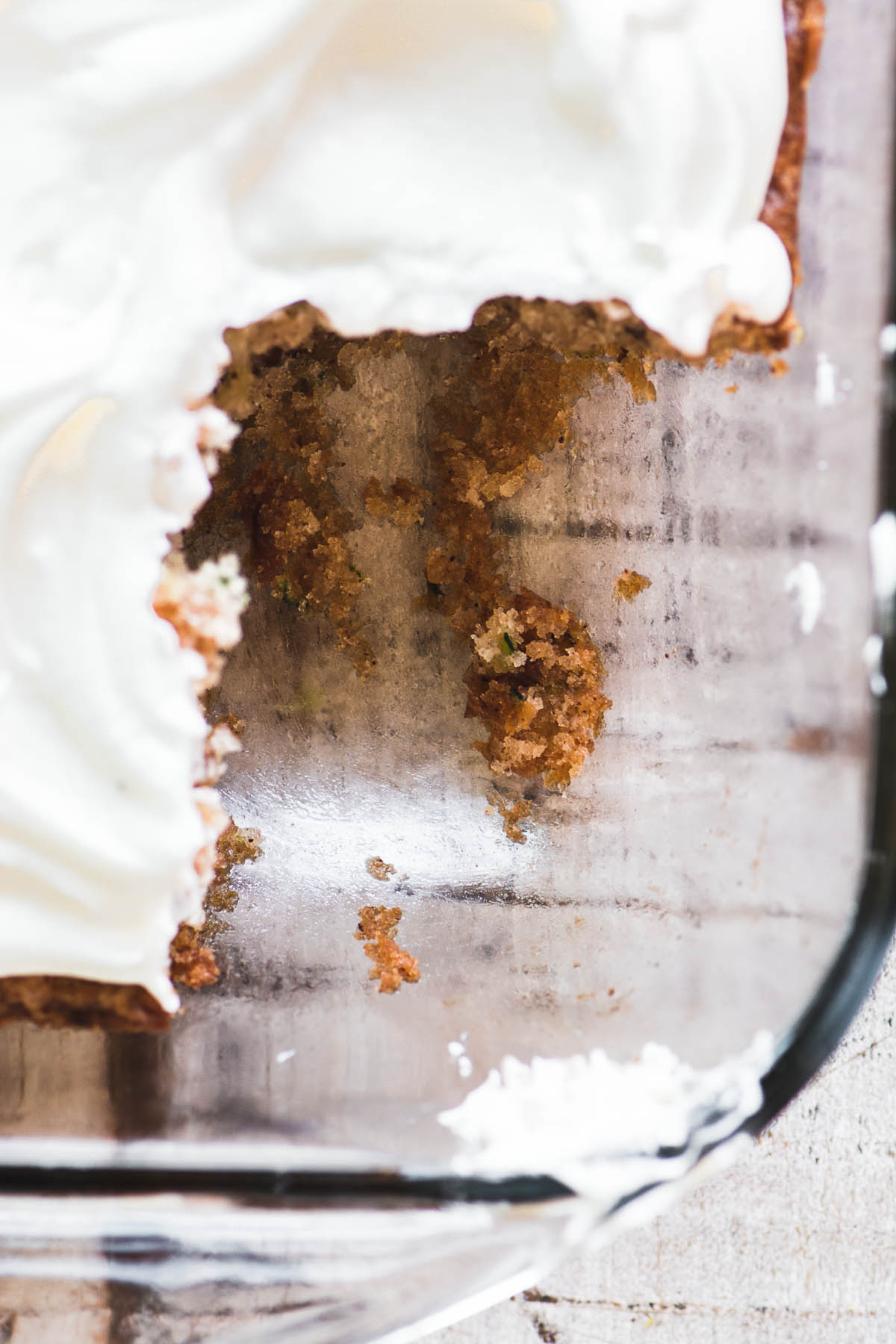 A pan of old fashioned zucchini cake with piece removed