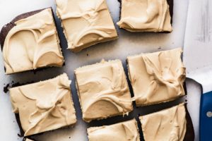 a batch of brownies with peanut butter frosting, cut into squares