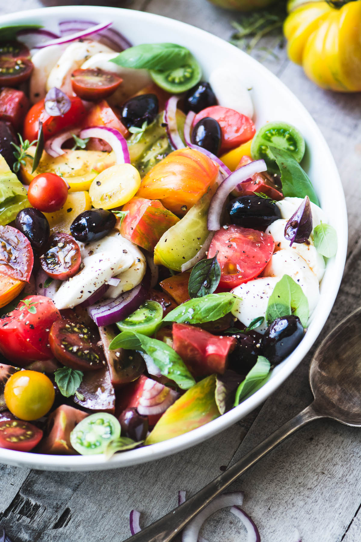 heirloom caprese salad in a white bowl