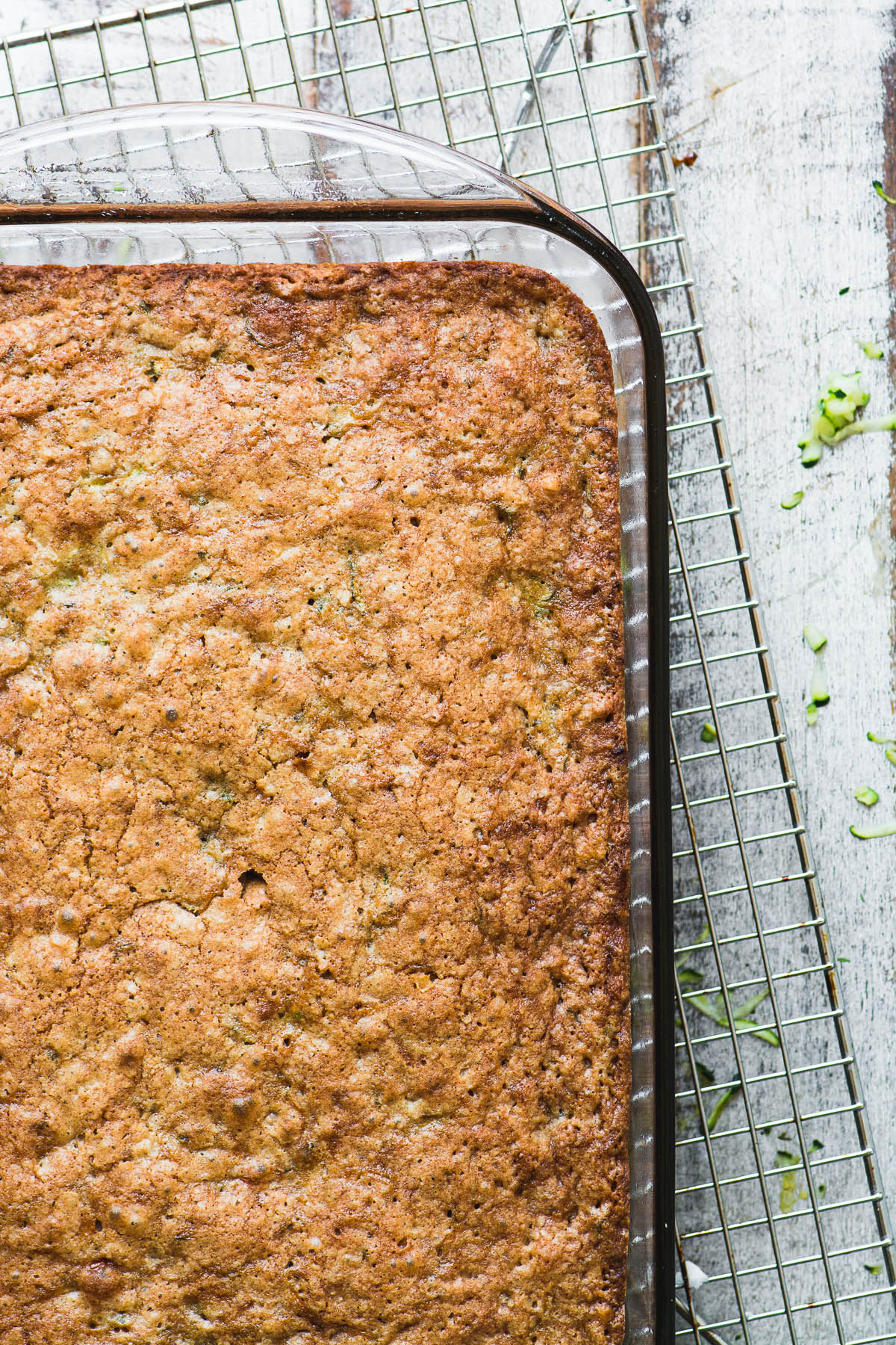 Old fashioned zucchini cake cooling on a rack