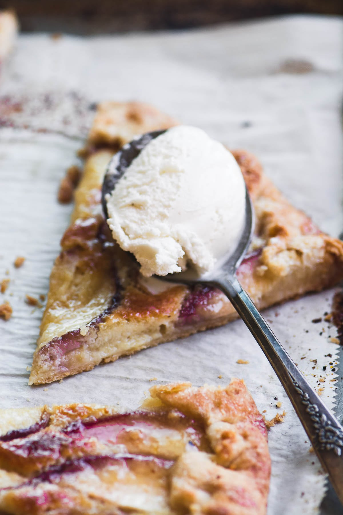 white peach frangipane galette partially cut, on a baking sheet