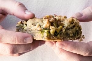 hands holding a zucchini walnut crumble bar