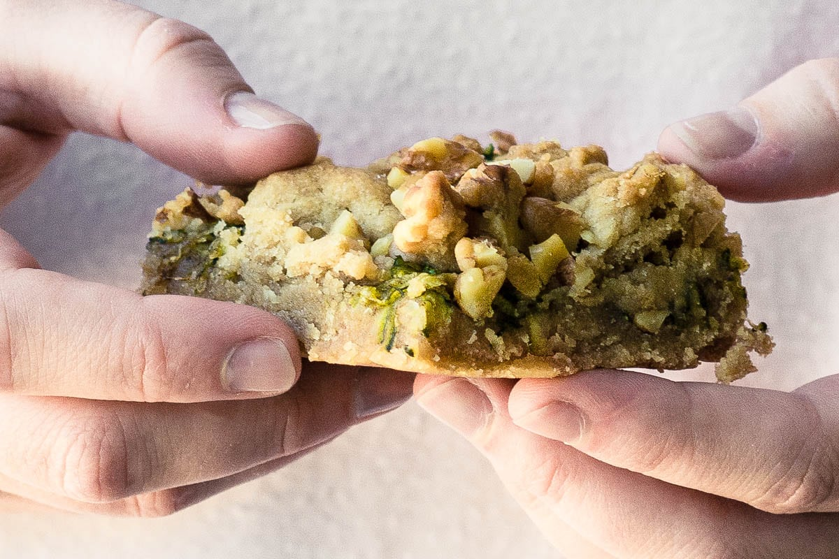hands holding a zucchini walnut crumble bar