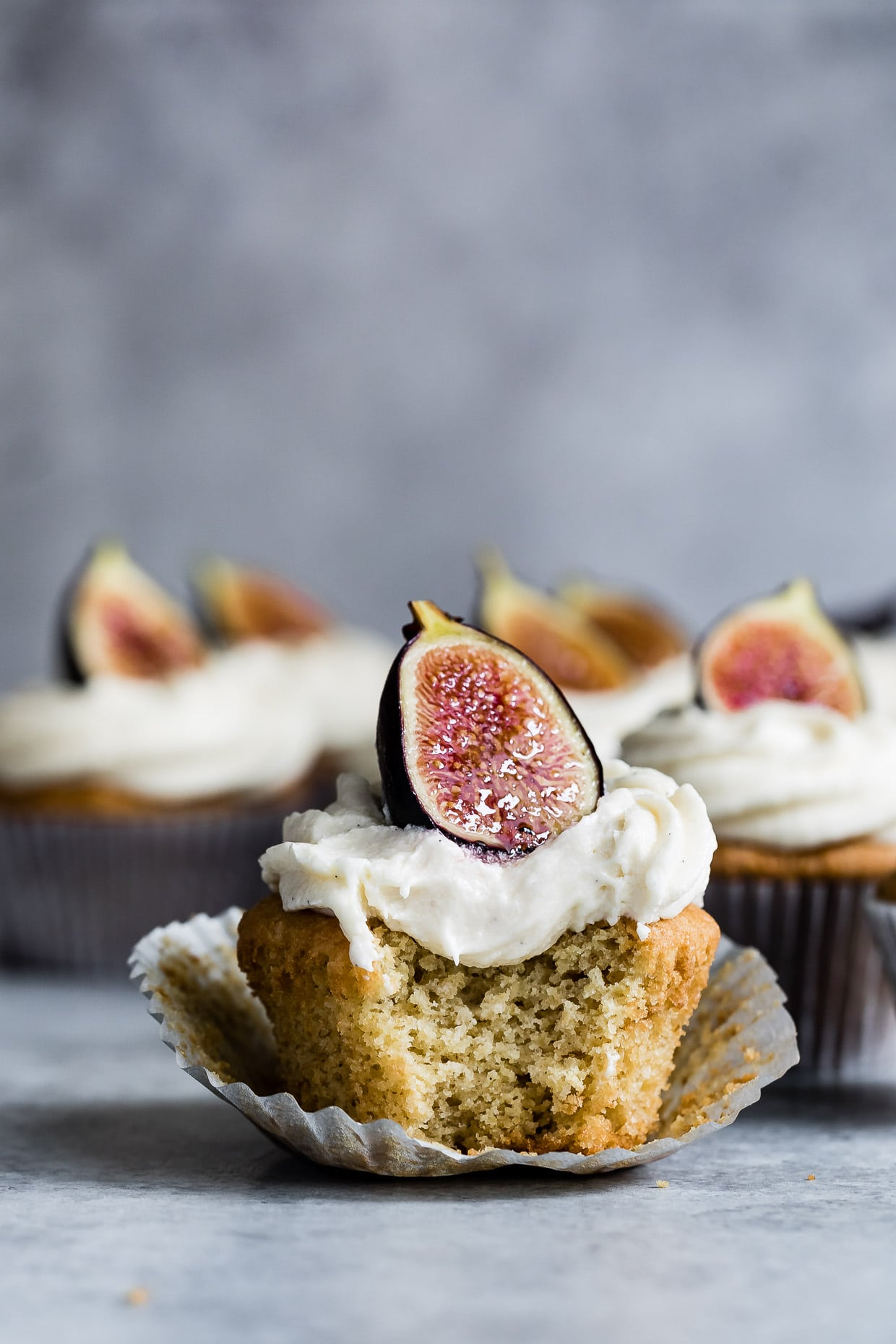 Vanilla cupcakes with goat cheese frosting and figs