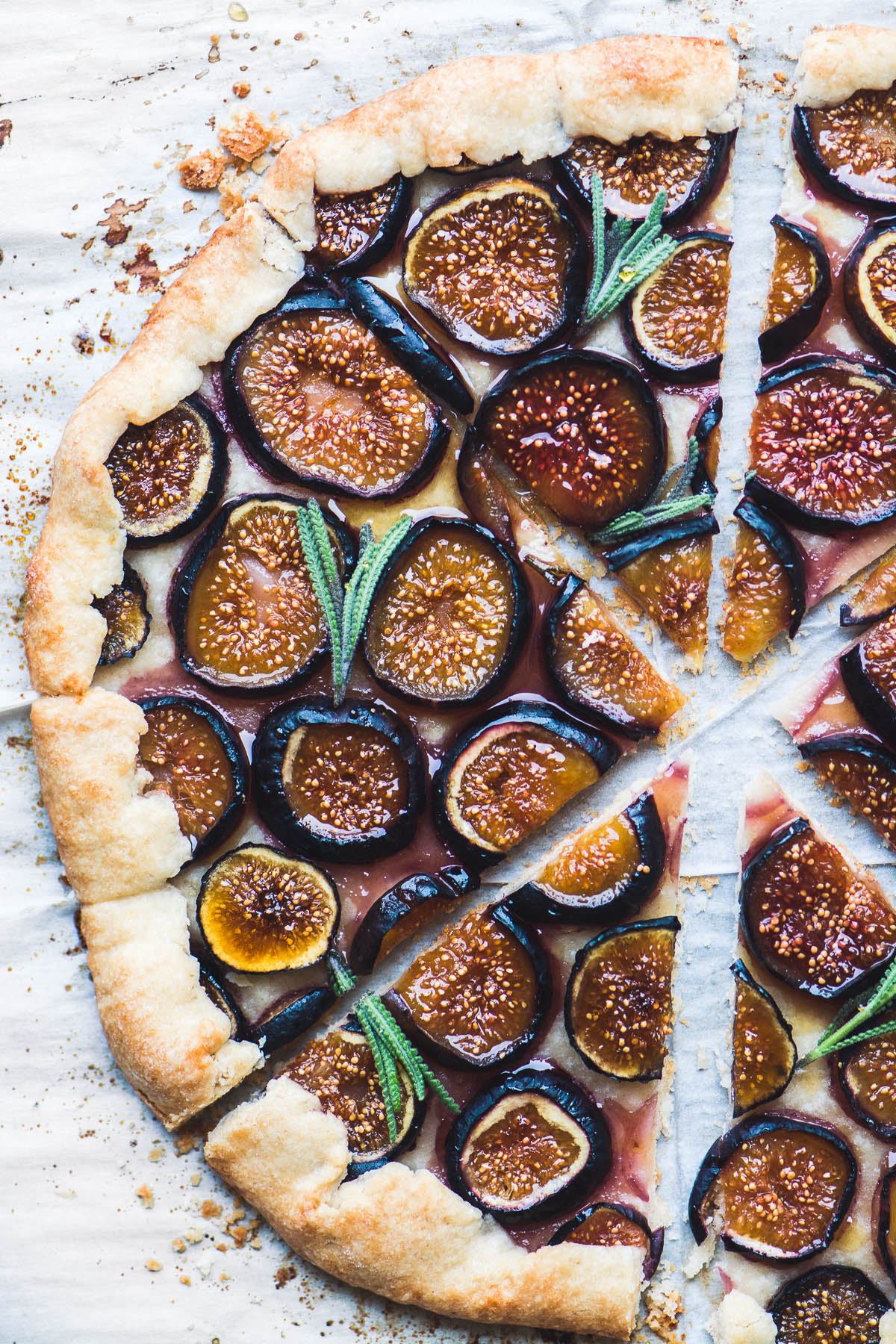 A fig tart with lavender honey on parchment paper