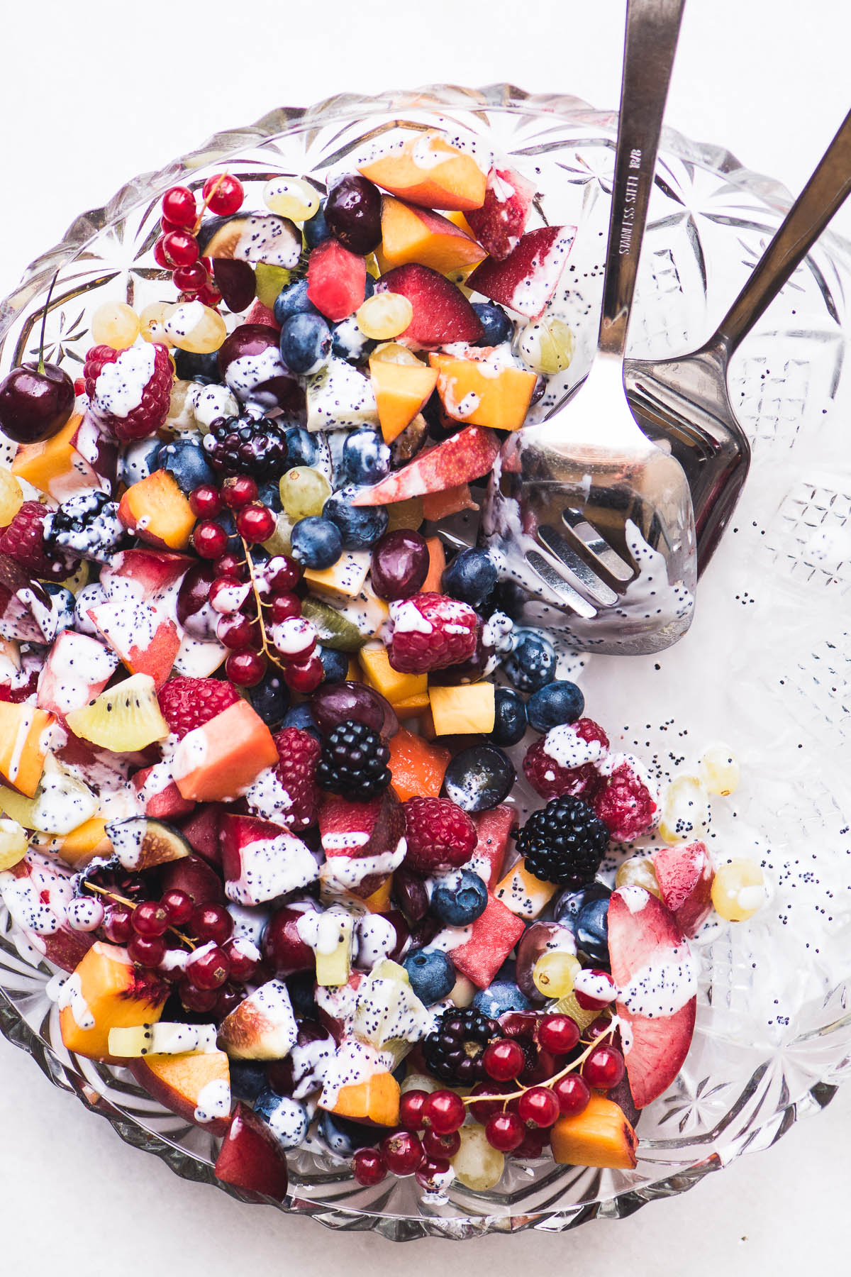 a bowl of summer fruit salad with kefir poppy seed dressing