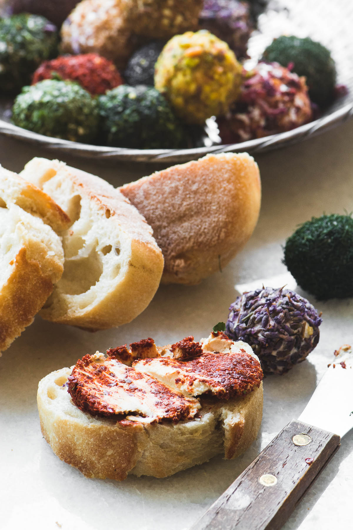 Jewel Box labneh Balls spread on crusty bread