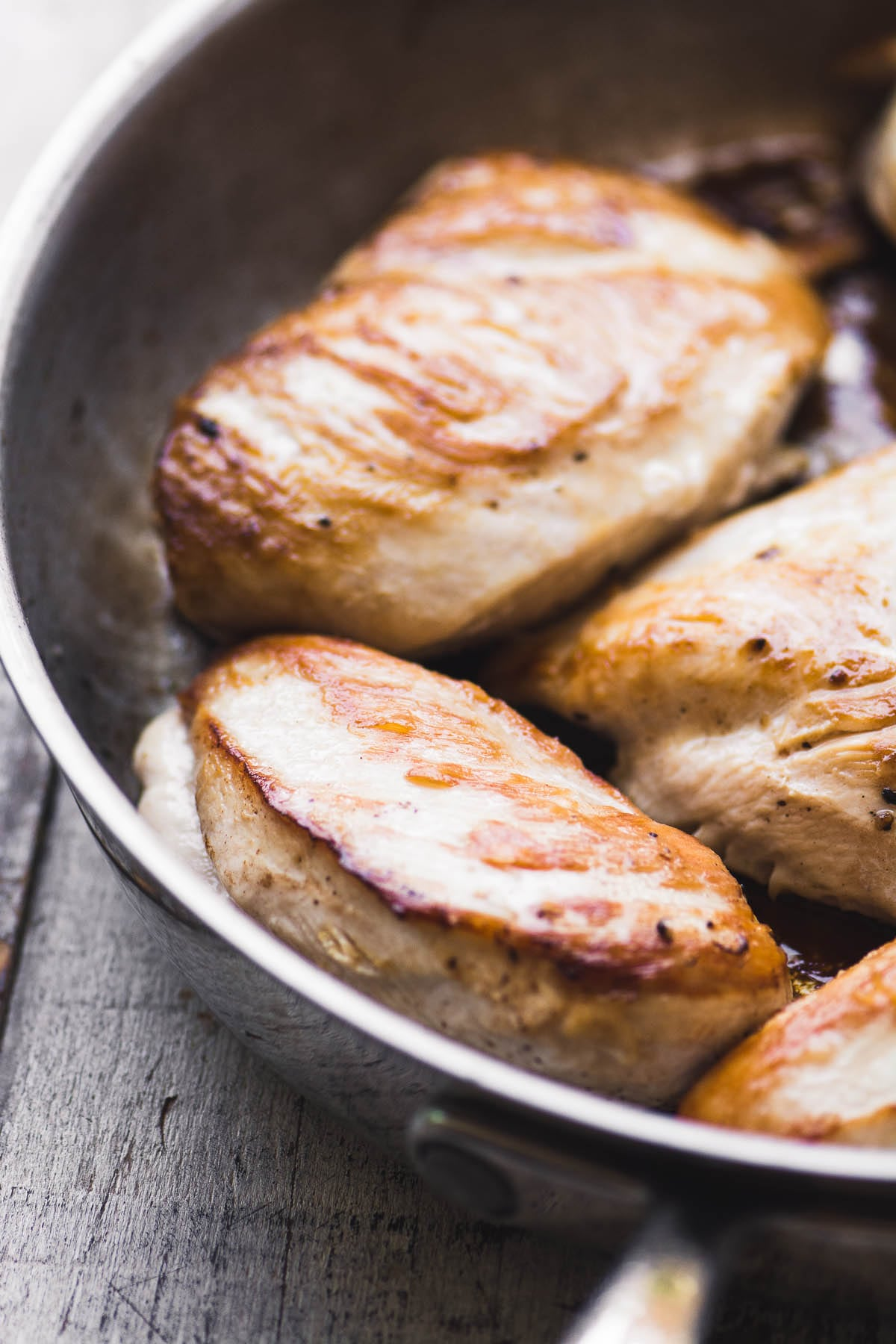 browning chicken breasts in a skillet to make Pizza Supreme Chicken