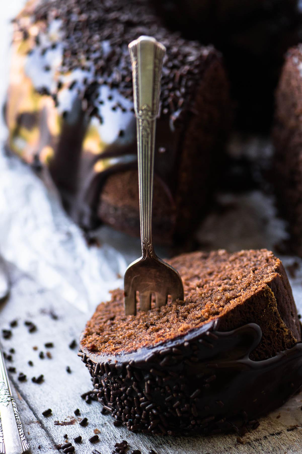 A slice of Chocolate Sour Cream Doughnut Bundt cake with a fork