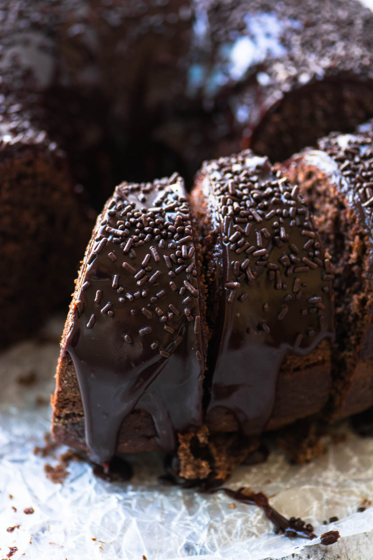 Chocolate Sour Cream Bundt Cake with Chocolate Sprinkles, sliced