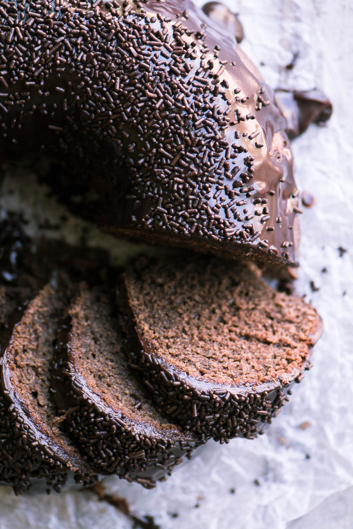 Chocolate Sour Cream Doughnut Bundt Cake, sliced, with sprinkles
