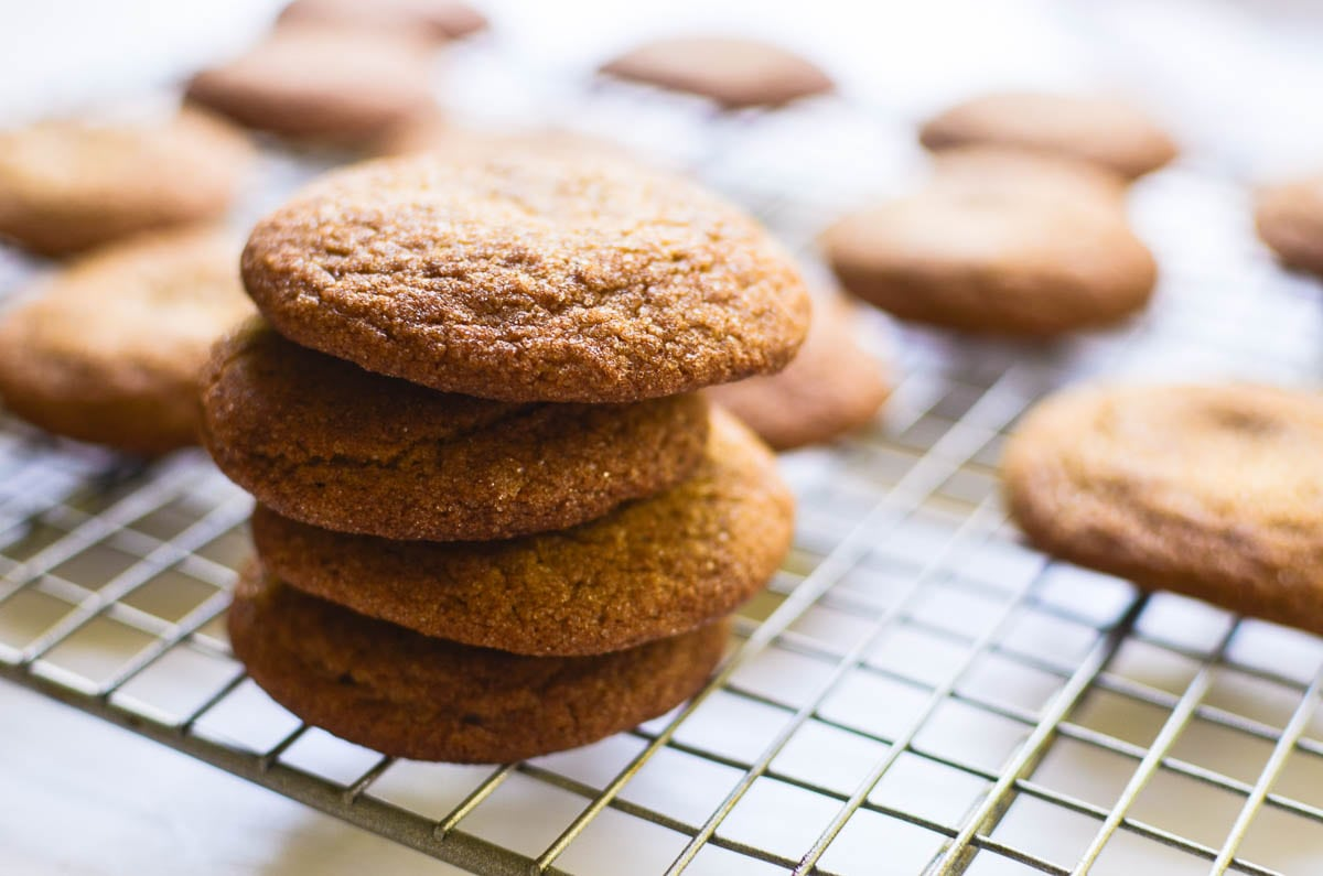 Gingerbread Snickerdoodles stacked on a cooling rack
