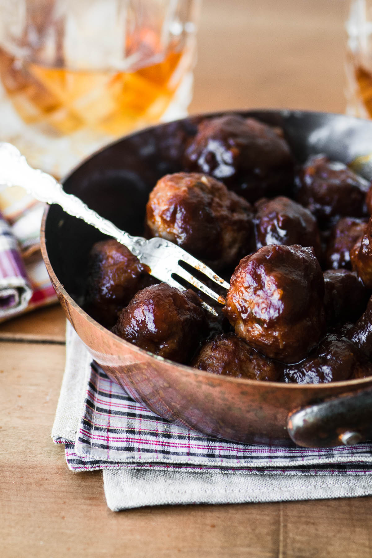 Apple Butter Brandy Meatballs in a skillet with a cocktail fork