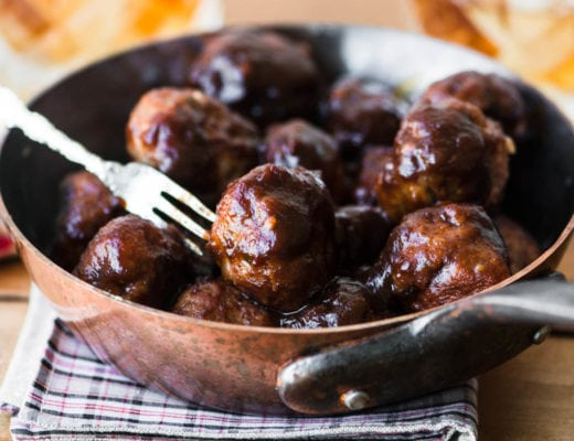 apple butter brandy meatballs in a small copper skillet