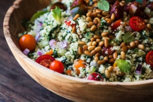 Cauliflower Rice Tabbouleh in a wooden bowl