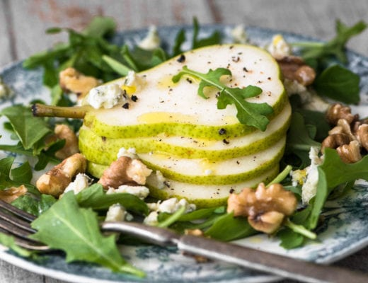 A plate of pear salad with creamy walnut vinaigrette