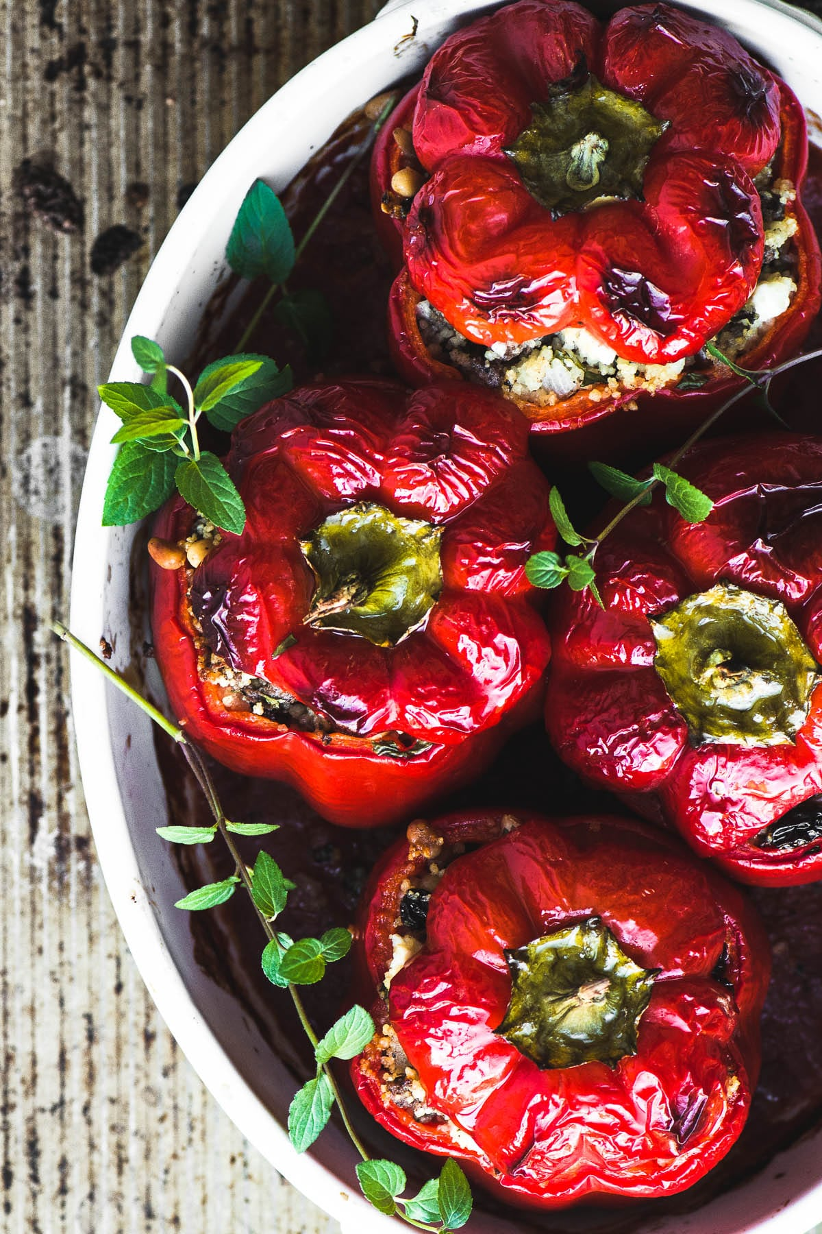 Spiced Lamb and Couscous Stuffed Red Peppers in a casserole dish